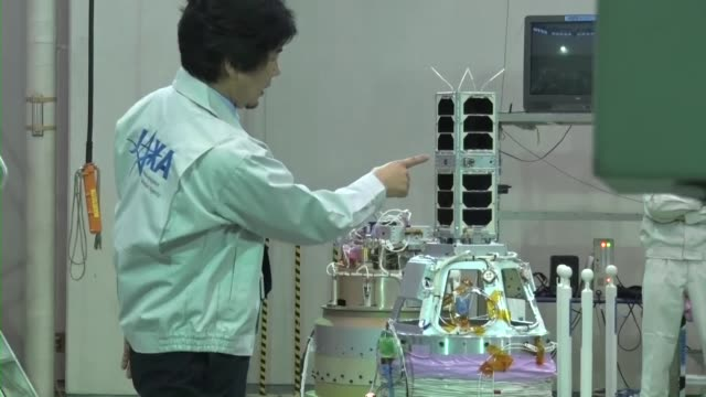 the tricom1 ultra small satellite developed by the university of tokyo is unveiled to the media at a facility of the japan aerospace exploration... - small stock videos & royalty-free footage