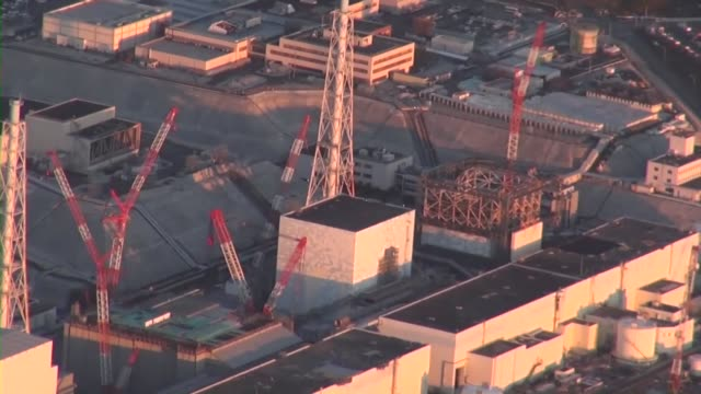 video shot from a kyodo news airplane shows the destroyed no 1 reactor building at the disasterhit fukushima daiichi nuclear plant after the removal... - ruined stock videos & royalty-free footage