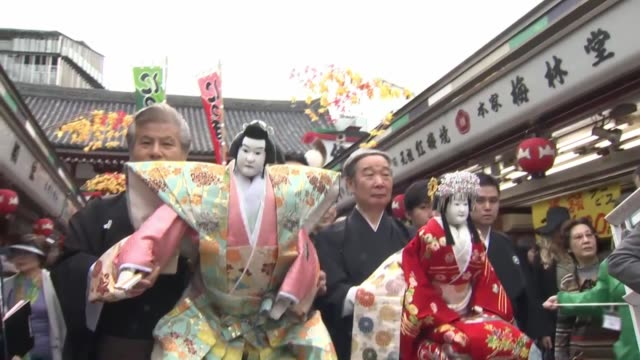 Performers of bunraku a Japanese traditional puppet show at the Kaminarimon gate in Tokyo's Asakusa district on Oct 14 prior to their staging at the...