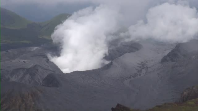 mt aso in southwestern japan erupts on oct 8 spewing volcanic ash 11000 meters into the sky it is unclear whether the eruption was related to a... - erupting stock videos & royalty-free footage
