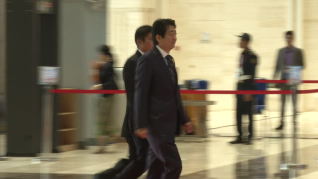 japan pm shinzō abe arrives at the association of southeast asian nations summit the laotian capital vientiane - association of southeast asian nations stock videos & royalty-free footage