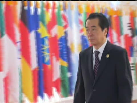 japan prime minister naoto kan walking at g20 summit in seoul - business or economy or employment and labor or financial market or finance or agriculture点の映像素材/bロール