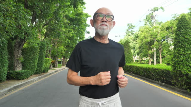 japan senior adult  exercising jogging - grey hair stock videos & royalty-free footage