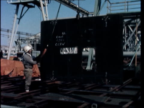 stockvideo's en b-roll-footage met japan shipbuilding; *also available as fs080277004* japan: tokyo: mitsui: air view mitsubishi shipyard zoom as cargo ship under construction deck... - audio available