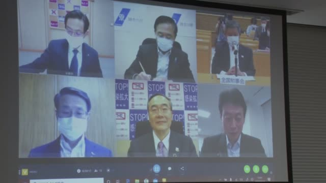 tokushima gov. kamon iizumi, who heads the national governors' association, speaks from an office in tokyo on may 13 via video conference to other... - teleworking stock videos & royalty-free footage