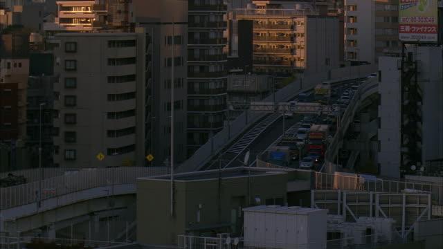 ms, ha, pan, japan, tokyo, elevated highway and office buildings - 2005年点の映像素材/bロール
