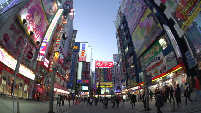 japan, tokyo, neon signs cover buildings in the consumer electronics district of akihabara - akihabara stock videos and b-roll footage