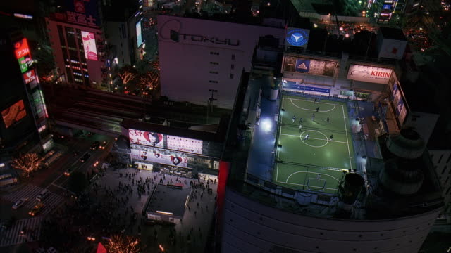 ms, ha, japan, tokyo, soccer game on top of building and cityscape at night - unknown gender stock videos & royalty-free footage