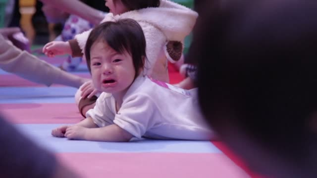 japan wins the guinness world record for the largest crawling competition with 601 babies taking part in the race in yokohama - contest stock videos & royalty-free footage