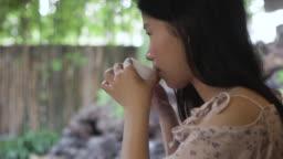Japan woman sip green tea in garden