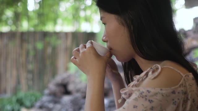 japan woman sip green tea in garden - tea hot drink stock videos & royalty-free footage