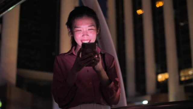 japan woman texting on mobile phone after work - only teenage girls stock videos & royalty-free footage