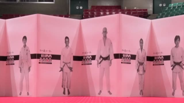 movie taken aug 21 at tokyo's nippon budokan hall shows a poster promoting the world judo championships beginning aug 25 there the 600meterlong... - sports poster stock videos & royalty-free footage