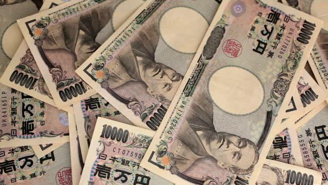 vidéos et rushes de avoir de 10 000 yens japonais. - symbole du yen