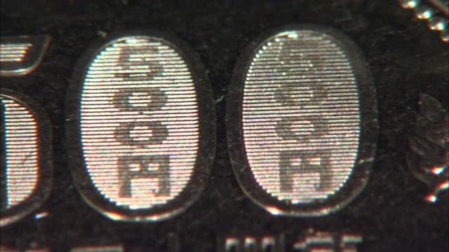 japanese 500 yen coin - 極端なクローズアップ点の映像素材/bロール
