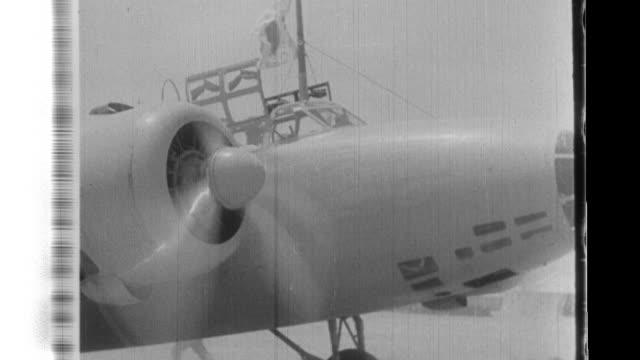 vidéos et rushes de japanese airmen prepare mitsubishi ki2 bombers at the army aerodrome in yuncheng china before starting on a raid to bomb chongqing - guerre du pacifique