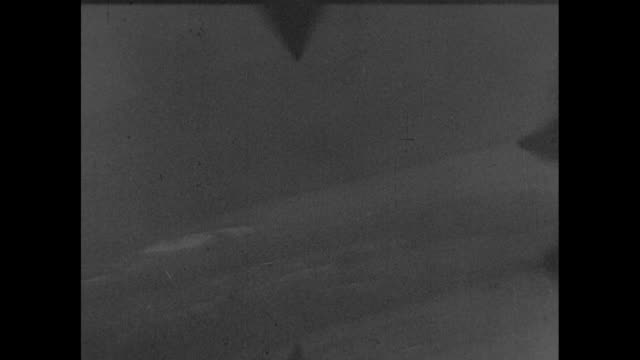 Japanese airplane seen POV through an American plane's viewfinder / Note exact day not known film has nitrate deterioration