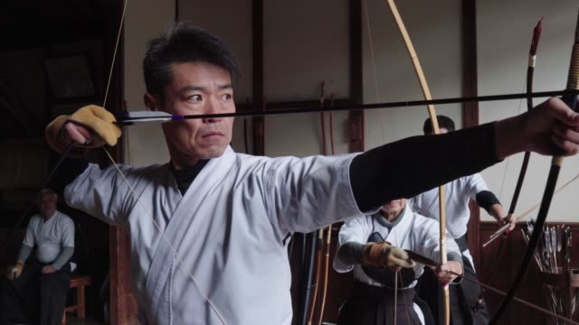 japanese archer readies his bow and takes his shot - archery stock videos and b-roll footage
