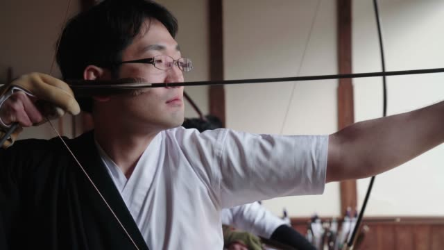 japanese archer readies his bow and takes his shot - arrow bow and arrow stock videos & royalty-free footage