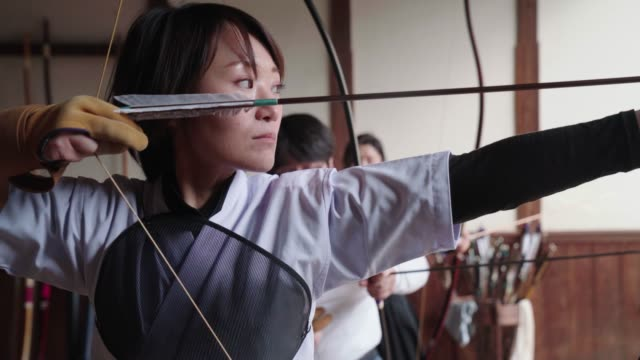japanese archer readying her bow and taking her shot - sports team stock videos & royalty-free footage