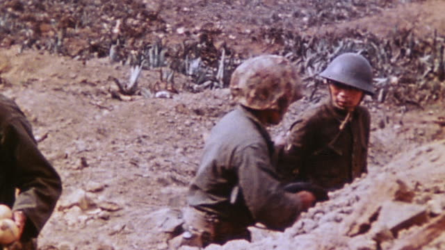 japanese army soldiers surrendering to marines crawling from tunnel mouth with their hands high as instructed and many grinning / iwo jima japan - iwo jima island stock videos & royalty-free footage