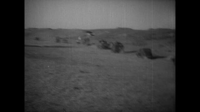 Japanese army units drive across Ordos Plateau while gunfire tags the cavalry and an artillery unit rushes to the enemy line