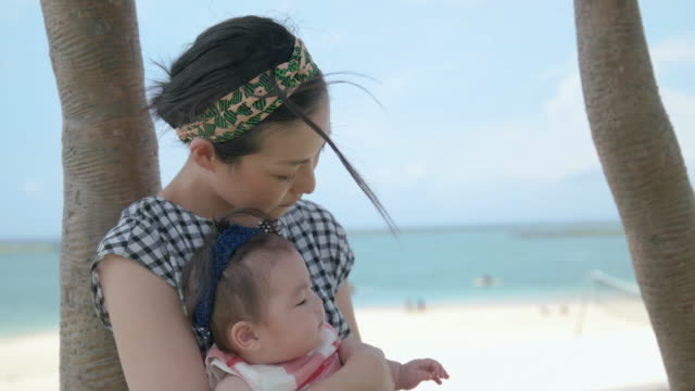 4k, japanese baby and mother in the park. - two generation family stock videos & royalty-free footage