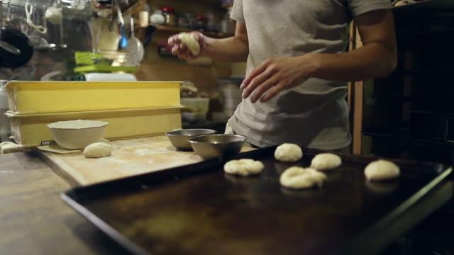 a japanese baker prepares dough for baking - baking sheet stock videos & royalty-free footage