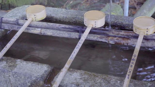 japanese bamboo dippers - shinto shrine stock videos & royalty-free footage
