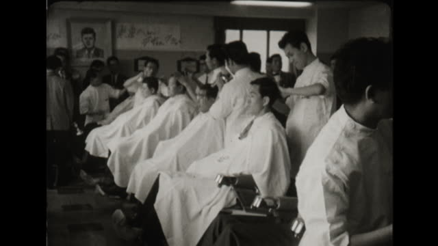 japanese barber shop gives jfk style haircuts - 1960 stock videos & royalty-free footage