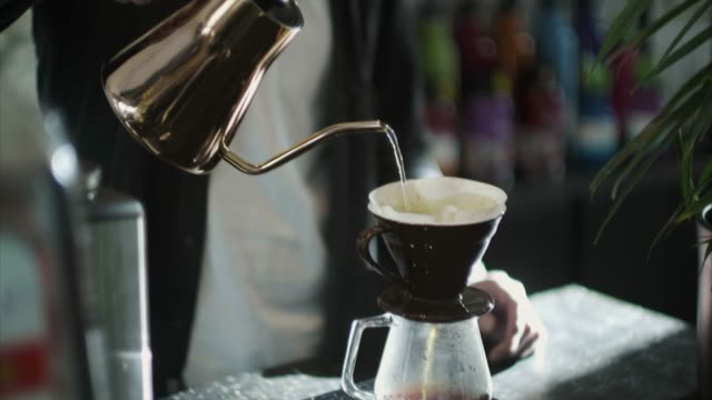 japanese barista pouring hot water over grounded coffee (slow motion) - 35 39 years stock videos & royalty-free footage