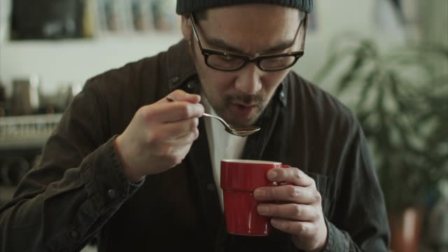 japanese barista tastes fresh coffee (slow motion) - catering occupation stock videos & royalty-free footage