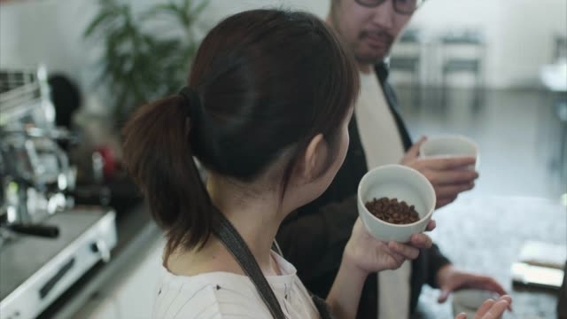 Japanese baristas compare different coffee roasts