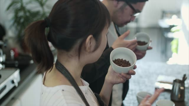 Japanese baristas compare different coffee roasts (slow motion)