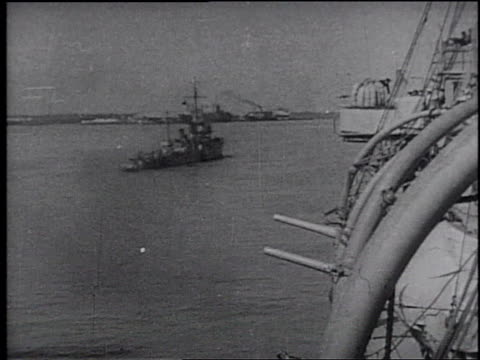 japanese battleship at sea / japanese flag waving / japanese soldier aboard a battleship / bomb falling from an airplane / explosion from a bomb /... - フランク キャプラ点の映像素材/bロール