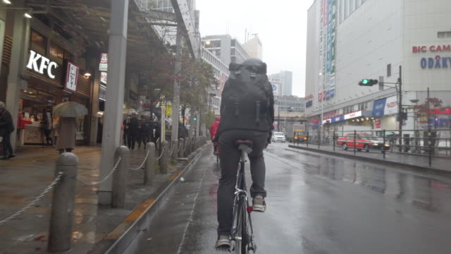 japanese bike messenger riding in rainy tokyo - rain stock videos & royalty-free footage