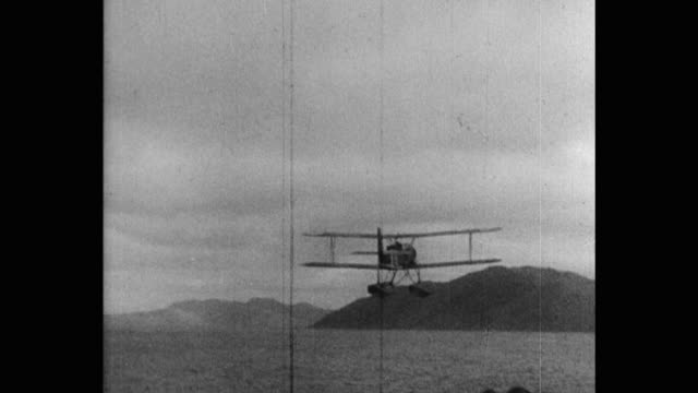 japanese biplane to takes off from carrier at sea - 日本の軍事力点の映像素材/bロール