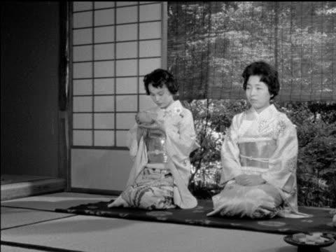 vídeos y material grabado en eventos de stock de / japanese buddhist ceremony / woman performing tea ritual. japanese women perform tea ritual on january 01, 1950 in japan - sado
