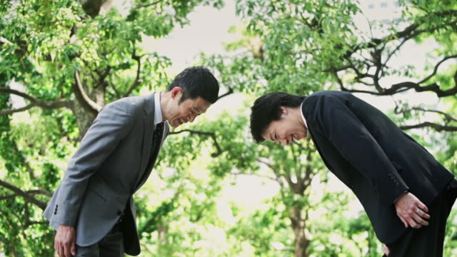 japanese business greeting - colleague stock videos & royalty-free footage