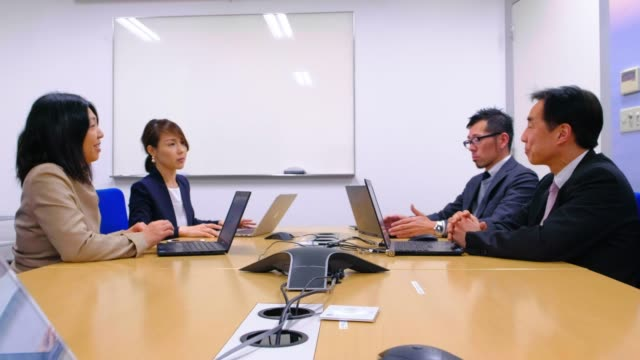 japanese business people in the office - business meeting stock videos & royalty-free footage