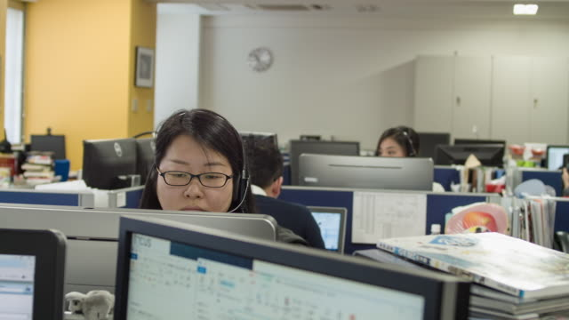 japanese business person working in office. - spectacles stock videos & royalty-free footage