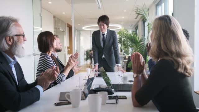 japanese businessman bowing in acknowledgement of applause - bowing stock videos & royalty-free footage