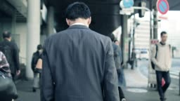 Japanese businessman going to work in the morning