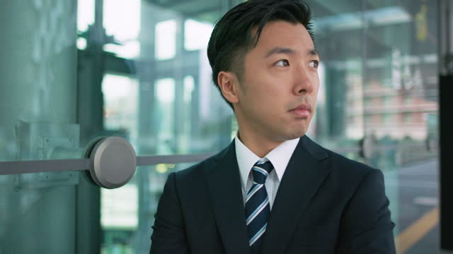 a japanese businessman looks into the distance - only japanese stock videos & royalty-free footage