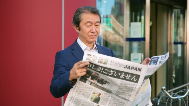 japanese businessman reading newspaper - old newspaper stock videos and b-roll footage
