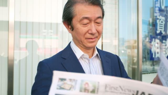 Japanese Businessman Reading Newspaper