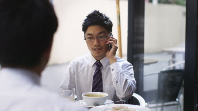 MS A Japanese businessman talks on his phone / Tokyo, Japan