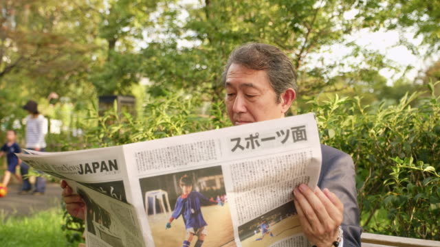 Japanese Businessman with a Newspaper
