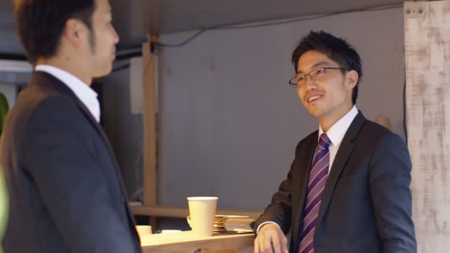 ms japanese businessmen talk in a cafe / tokyo, japan - lunch break stock videos & royalty-free footage