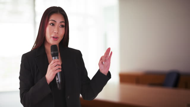 japanese businesswoman talking in a meeting - public speaker stock videos & royalty-free footage